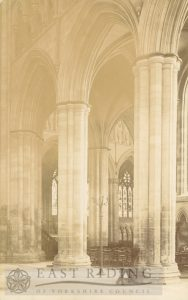 Beverley Minster interior, north transept west aisle piers, with east end of nave in background, Beverley 1900s