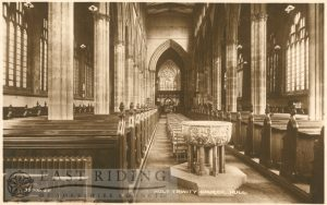 Holy Trinity Church, interior from west showing font and aisle, Hull c.1900s